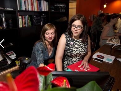 Nicole Sullivan (left) works with an employee at the newly opened BookBar in Denver. Photo provided.